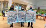 I manifesti con i disegni dei bambini creati durante il lockdown abbelliscono le scuole